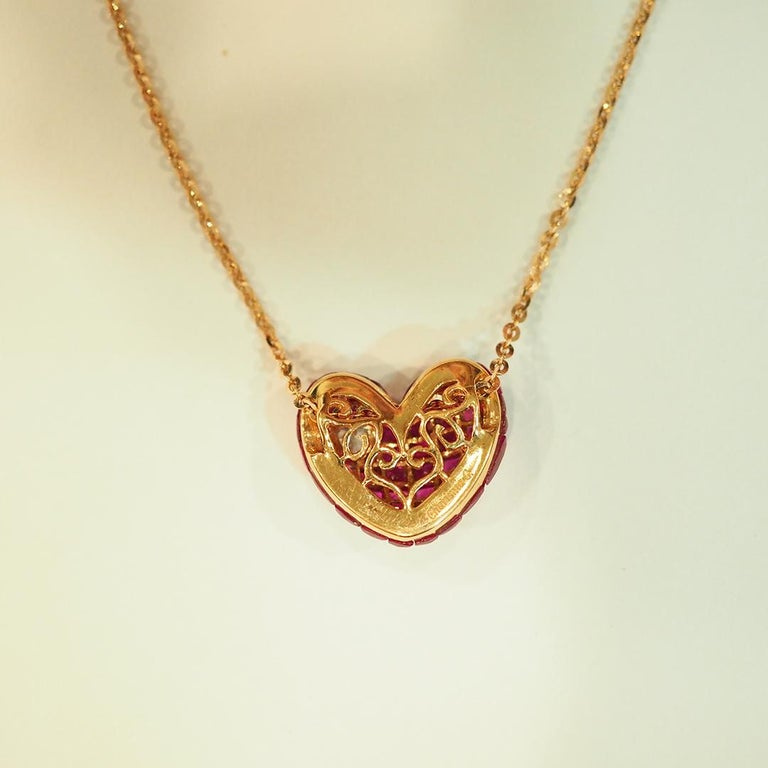 Round Cut 18 Karat Rose Gold Ruby and Diamond Heart Pendant Invisible Setting For Sale