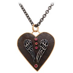 18 Karat Rose Gold, Sterling Silver, and Rusted Iron Heart Necklace with Rubies