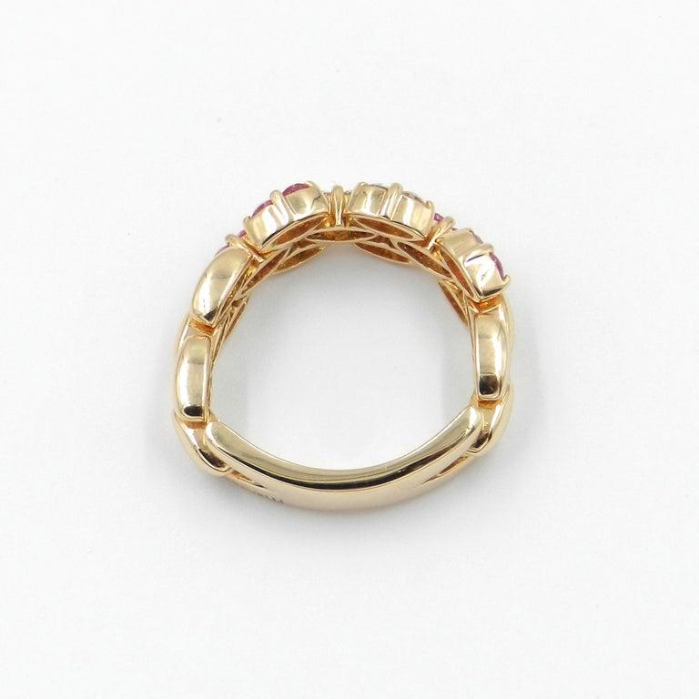 Round Cut 18 Karat Rose Gold White Diamonds and Pink Sapphires Garavelli Ring For Sale