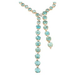 18 Karat Rose Gold with Apatite and White Diamonds Set