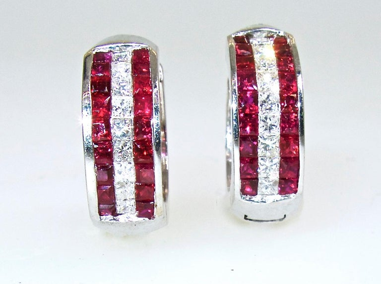 Fancy cut French cut diamonds, 18 in number, are all well cut and well matched and near colorless (G), and very slightly included (VS) in clarity.  There is approximately .90 cts.  The natural rubies are a bright vivid red. There are 36 stones