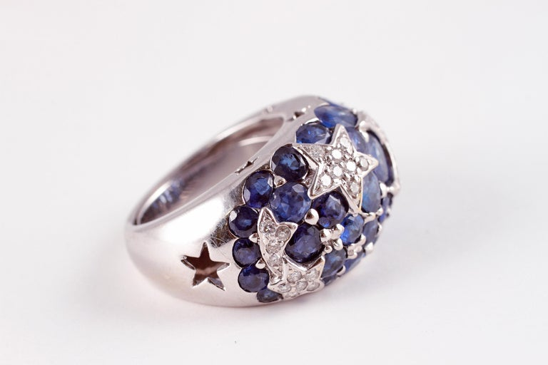 From a Florida estate, this stunning white gold, blue sapphire and diamond ring was purchased from A. B. Levy of Palm Beach and features 0.40 carats of diamonds in the shapes of stars and a crescent moon and over 6.00 carats of blue sapphires.   The