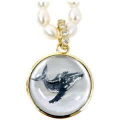 18 Karat Sapphire Reverse Crystal Carving of a Whale Family Pendant in 18 Karat