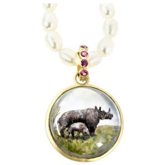 18 Karat Sapphire Reverse Crystal Carving of Rhinocerous Family Pendant