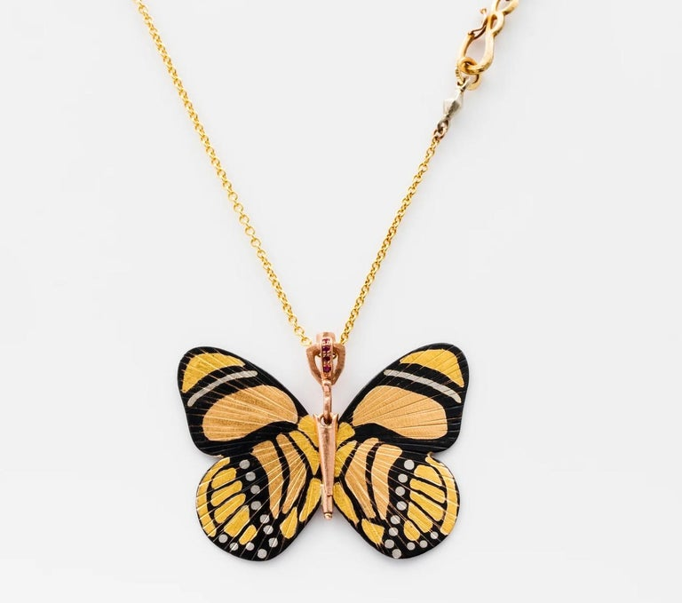 James Banks's signature butterfly necklace features a Large Callicore Butterfly with a hinge at the center to allow movement of the wings, set in 18k Rose Gold, 18k Yellow Gold, 18k White Gold, Shakudo, hung on an 18k Yellow Gold Chain with a secure