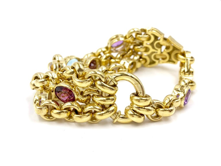 Oval Cut 18 Karat Solid Link Bracelet with Scattered Semi Precious Gemstones For Sale
