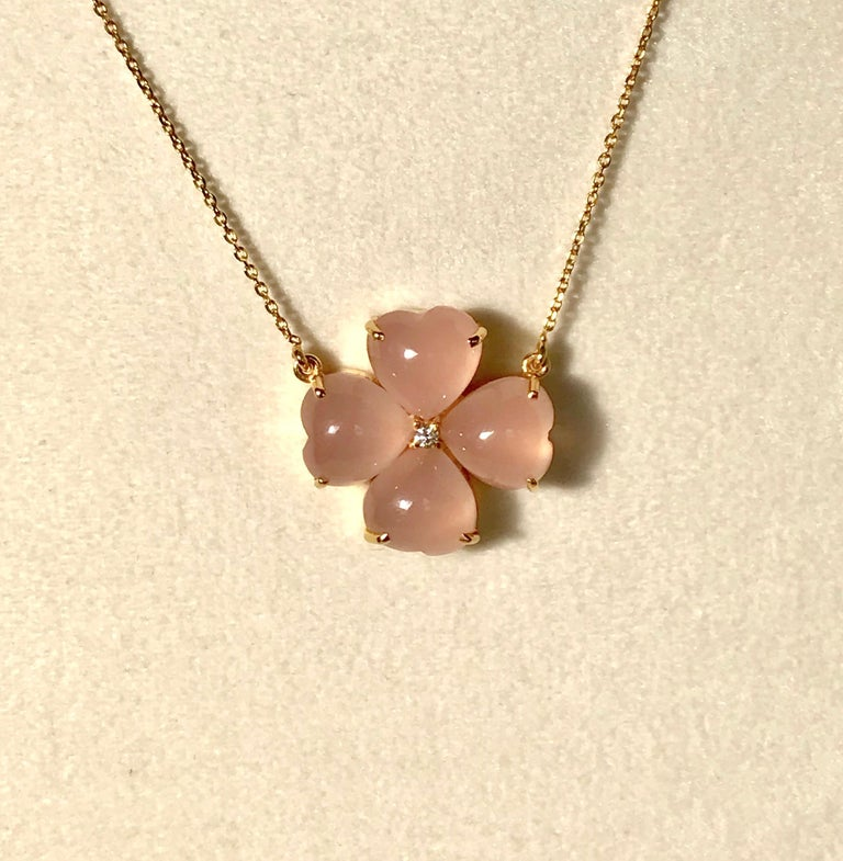 Handmade necklace with pink chalcedony stones and a diamond centre.  Four leaves clover is a symbol of good luck and happiness.  Those who find a four-leaf clover are destined for good luck, as each leaf in the clover symbolises faith, hope, love,