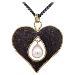 18 Karat, Sterling Silver, and Rusted Iron Heart Necklace with a Pearl