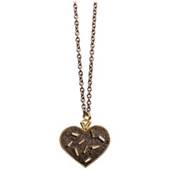 18 Karat, Sterling Silver, and Rusted Iron Heart Necklace with Baguette Diamonds