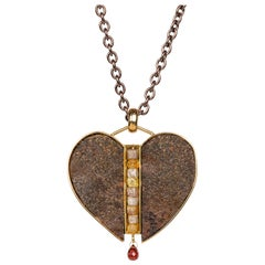18 Karat Sterling Silver and Rusted Iron Heart Necklace with Garnet and Diamonds