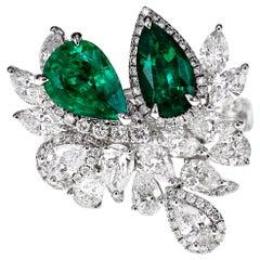 18 Karat Striking Green Natural Emerald and White Diamond Ring