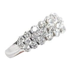 18 Karat Tapered Round White Prong Set Diamonds Band Style Ring