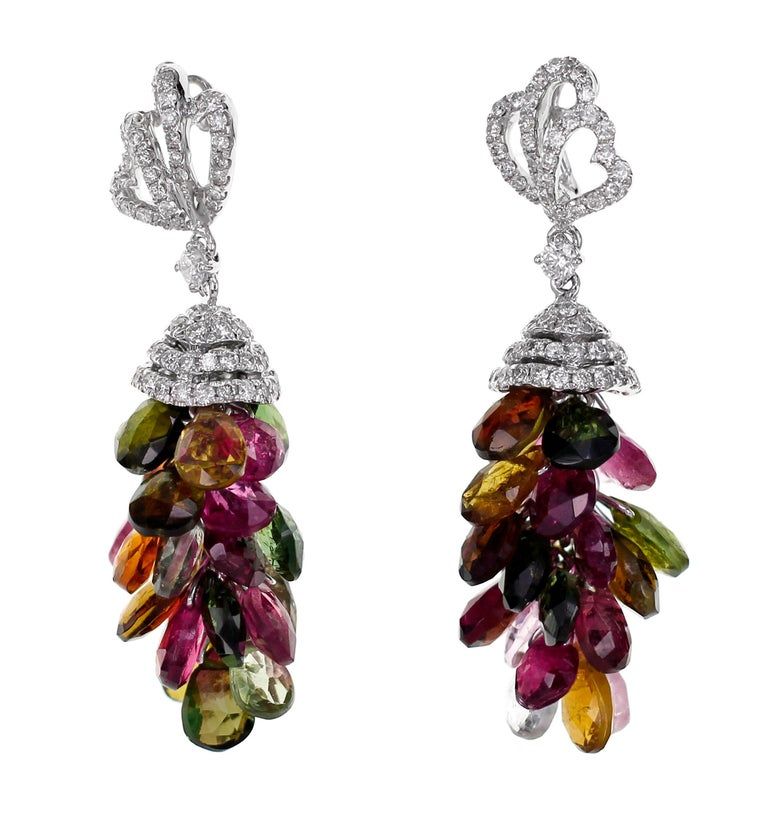 From Malpani Grandiosa Collection, the earring has 0.92 carats of diamond and 18.54 carats of  mix color tourmaline,  The length of the earring is 3.5 cm and the width is 1.4 cm.