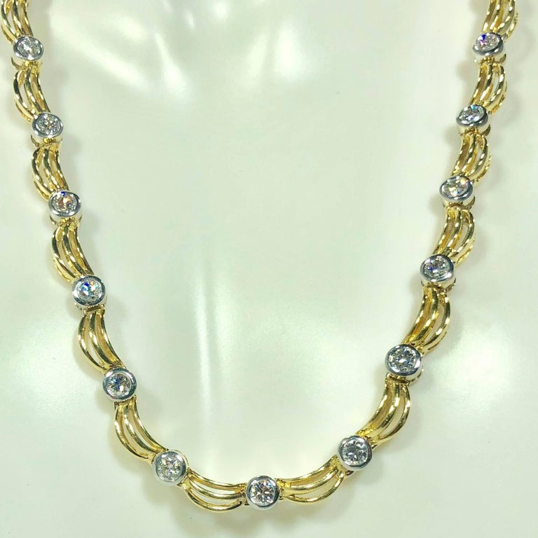 18 karat 2 tone white/yellow gold and 1.0 carat diamond fancy link necklace. This substantial 18 karat yellow and white gold two toned creation weighs 40.7 grams, 26.2 dwt.. The fancy link style and design of this piece  incorporates circular