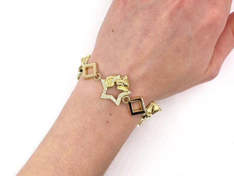 18 Karat Vintage Star Animal Charm Bracelet with Diamonds and Rubies For Sale 5