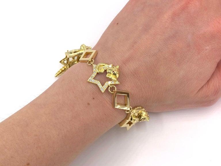 18 Karat Vintage Star Animal Charm Bracelet with Diamonds and Rubies For Sale 6