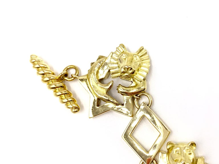 18 Karat Vintage Star Animal Charm Bracelet with Diamonds and Rubies In Good Condition For Sale In Pikesville, MD