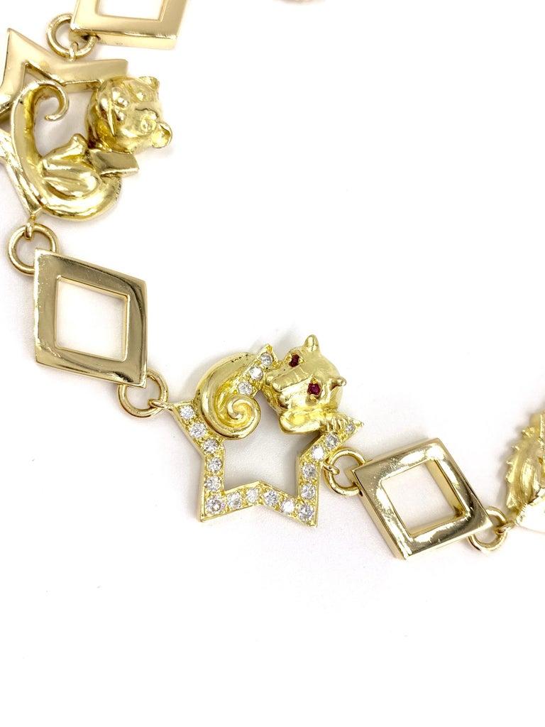 18 Karat Vintage Star Animal Charm Bracelet with Diamonds and Rubies For Sale 1