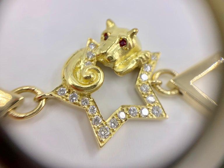 18 Karat Vintage Star Animal Charm Bracelet with Diamonds and Rubies For Sale 2