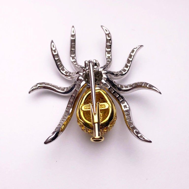 Whimsical and wearable is the best way to describe this lovely spider brooch. Designed with 1.00 carats of brilliant cut diamonds and 1.97 carats of brilliant cut yellow sapphires. The spider measures 1.25