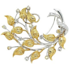 18 Karat White and Yellow Gold Flower Brooch with 0.90 Carat Diamonds
