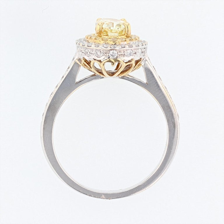 Oval Cut 18 Karat White and Yellow Gold GIA Certified Fancy Light Yellow Diamond Ring