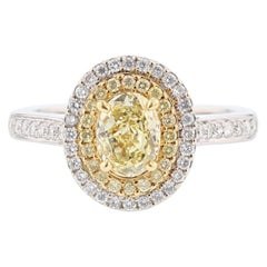 18 Karat White and Yellow Gold GIA Certified Fancy Light Yellow Diamond Ring