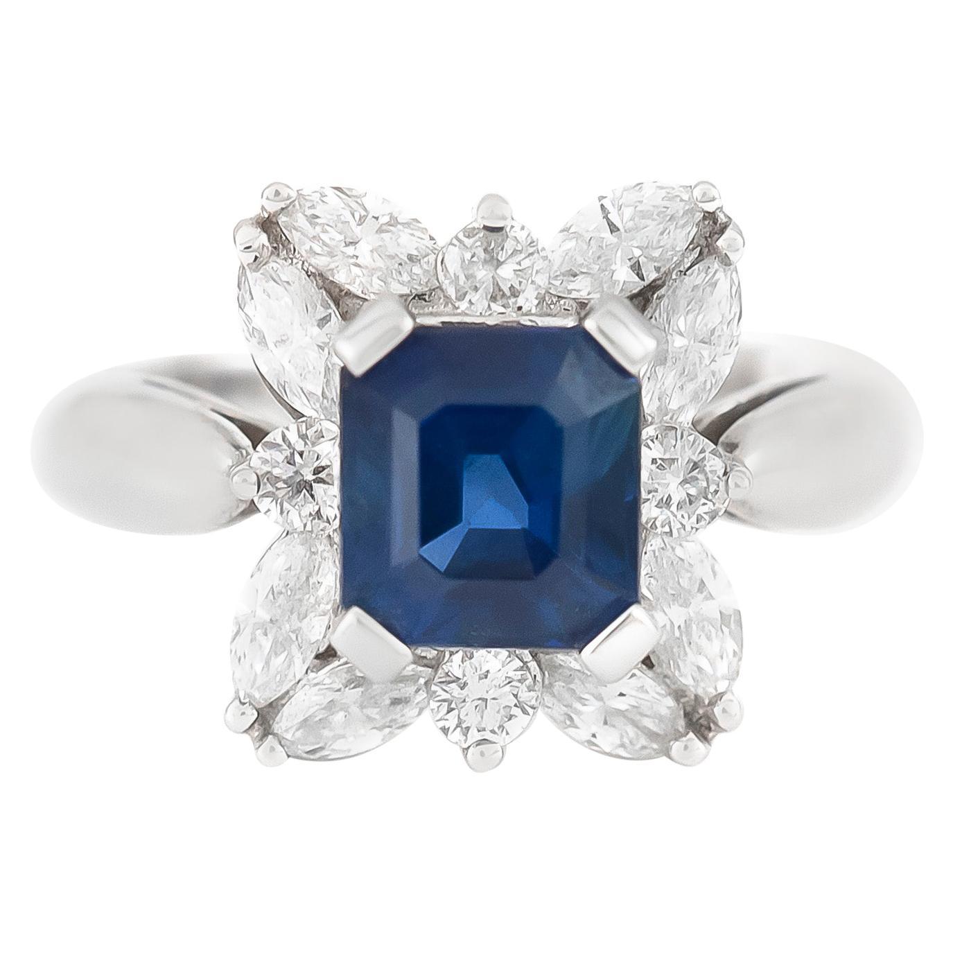 18 Karat White Diamonds Flower Setting with Center Sapphire
