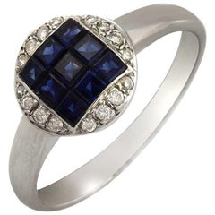 18 Karat White Gold 0.09 Carat Diamonds and 1.37 Carat Blue Sapphire Ring