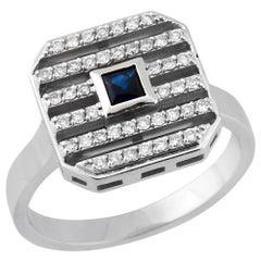 18 Karat White Gold, 0.28 Carat White Diamonds, 0.15 Carat Sapphire Ring
