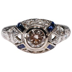 18 Karat White Gold 0.4 Carat Blue Sapphire 0.8 Carat White Diamond Halo Ring