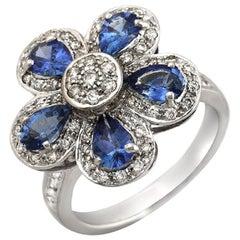 18 Karat White Gold 0.50 Carat Diamonds and 2.20 Carat Blue Sapphire Flower Ring