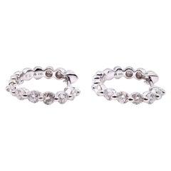 18 Karat White Gold 0.62 Carat Diamond Huggie Earrings
