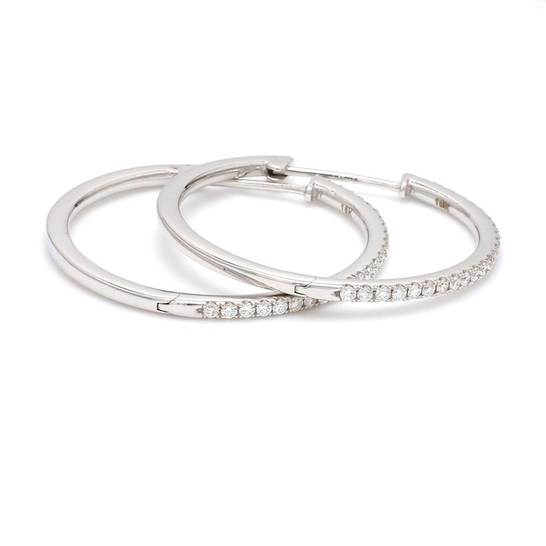 A Beautiful Handcrafted Hoop Earring in 18 karat White Gold with Natural Brilliant Cut Colorless Diamond . A Statement piece for Evening Wear  Natural Diamond Details Pieces : 50 Pieces Weight : 0.55 Carat  Clarity of Diamond : VS Colour of Diamond