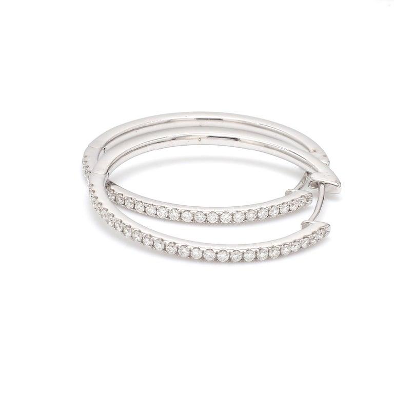 Contemporary 18 Karat White Gold 1/2 Carat Diamond Hoop Earring For Sale