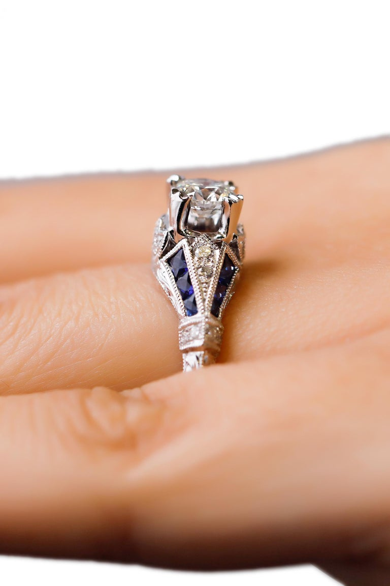 18 Karat White Gold 1.03 Ct Diamond 0.22 Ct Sapphire Engagement Ring  Triple cluster halo diamond engagement ring. Fashioned in white gold, is the perfect way to say