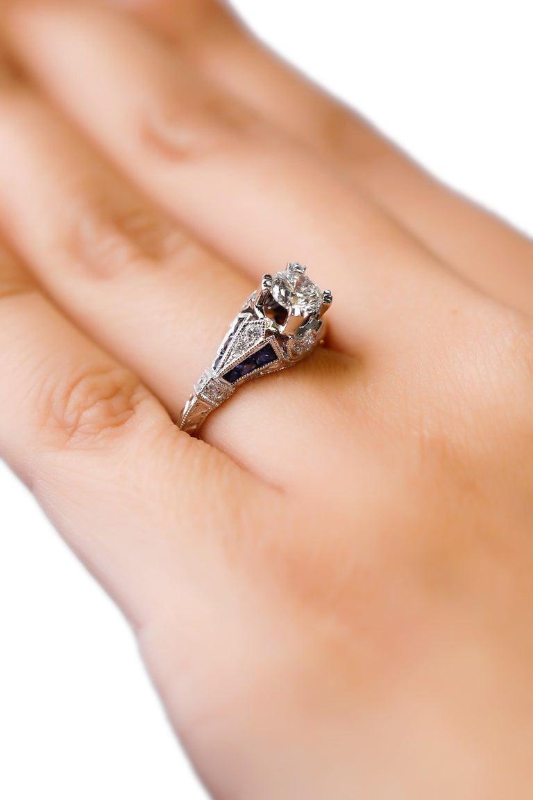 Modern 18 Karat White Gold 1.03 Carat Diamond 0.22 Carat Sapphire Engagement Ring For Sale