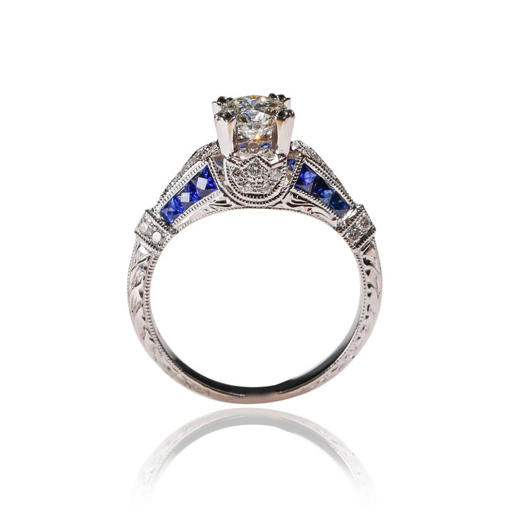 Round Cut 18 Karat White Gold 1.03 Carat Diamond 0.22 Carat Sapphire Engagement Ring For Sale