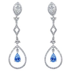 18 Karat White Gold 1.07 Carat White Diamonds 1.02 Carat Blue Sapphire Earrings