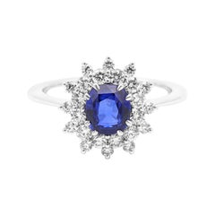 18 Karat White Gold 1.30 Carat Blue Sapphire Oval-Cut and Diamond Cluster Ring