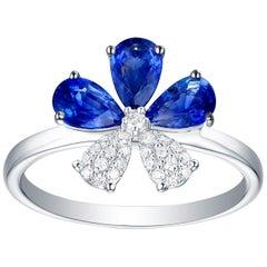 18 Karat White Gold 1.36 Carat Blue Sapphire Diamond Pave Flower Design Ring