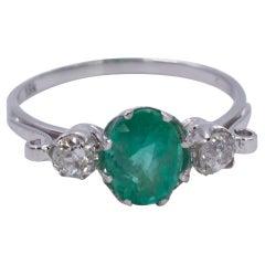 18 Karat White Gold, 2.30 ct Emerald and 0.34ct Diamond Three-Stone Ring, 1950s