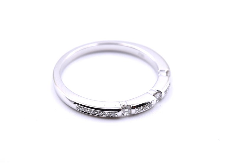 Designer: custom design Material: 18k white gold Diamonds: 21 round brilliant cut diamonds = 0.25 Color: H Clarity: SI1 Dimensions: band is 2mm wide Ring size: 7 (please allow two additional shipping days for sizing requests) Weight: 3.1 grams