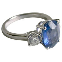 18 Karat White Gold 3-Stone Ring with Blue Sapphire and Diamonds