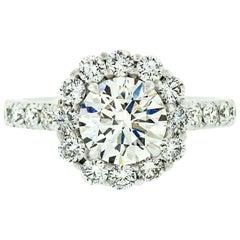 18 Karat White Gold 3.18 Carat GIA H VS2 Triple Ex Round Diamond Ring with Halo