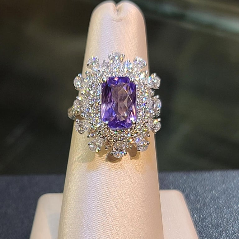 Sapp - 3.86ct   GUILD 13695017  Violet / NH / Sri Lanka Carat Weight: 3.86ct  / Shape and cut: Octagonal / Modified Brilliant Colour: Violet  Treatment: No Heat Origin: Sri Lanka Cert: Violet  White Diamond Weight: 2.45ct / Dia 76 pcs Ring Size: 6.5