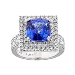 Cushion Cut Tanzanite and Diamond Accent Engagement Ring in 18k White Gold