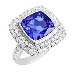 18 Karat White Gold 6.52 Carat Natural Tanzanite Ring with 68 VS/G Diamonds