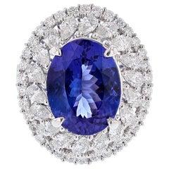 18 Karat White Gold 6.53 Carat Oval Tanzanite and Diamond Ring