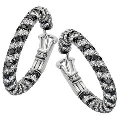 18 Karat White Gold 7.24 Carat Black and White Diamond Spiral Pave Hoop Earrings